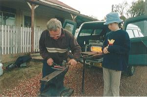 Shaping a horse shoe with Sally supervising