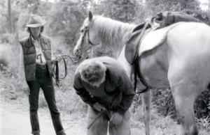 "Sandy Sutherland, farrier, providing ""road side service"" to a endurance competitor"